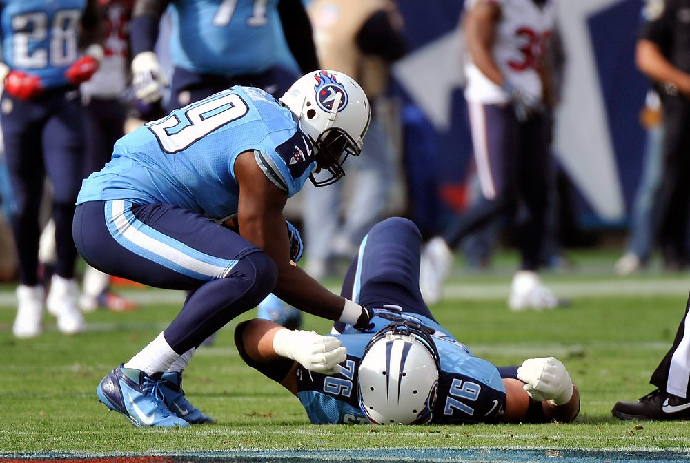 . David Stewart #76 of the Tennessee Titans lies injured on the field during a game againt the Houston Texans at LP Field on December 2, 2012 in Nashville, Tennessee.  (Photo by Frederick Breedon/Getty Images)