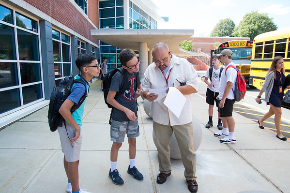 08/29/19 Wesley Bunnell | Staff Berlin High School students exit school after the first day of classes on Thursday August 29, 2019. Paul Germain helps students find their correct bus.