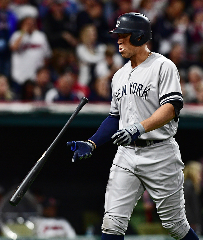 . New York Yankees\' Aaron Judge flips his bat after striking out in the third inning against the Cleveland Indians in Game 5 of a baseball American League Division Series, Wednesday, Oct. 11, 2017, in Cleveland. (AP Photo/David Dermer)