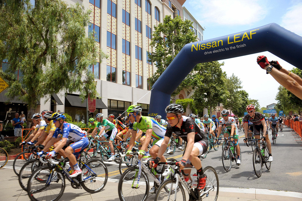 . Cyclists speed out at the start of Stage 4 of the Amgen Tour of California in Santa Clarita on Wednesday, May 15, 2013. (Robert Torre/Special to the Sentinel)