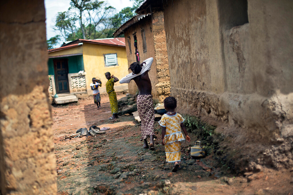 . In this photo taken Thursday Nov. 20, 2014, children walk in the Guinean village of Meliandou, some 400 miles (600 mms) south-east of Conakry, Guinea, believed to be Ebola\'s ground zero. (AP Photo/Jerome Delay)