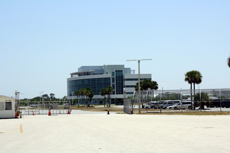 The Operations Support Building, as seen from the Vehicle Assembly Building.  Dignitaries such as Members of Congress and Cabinet-level officials watch launches from the balcony.