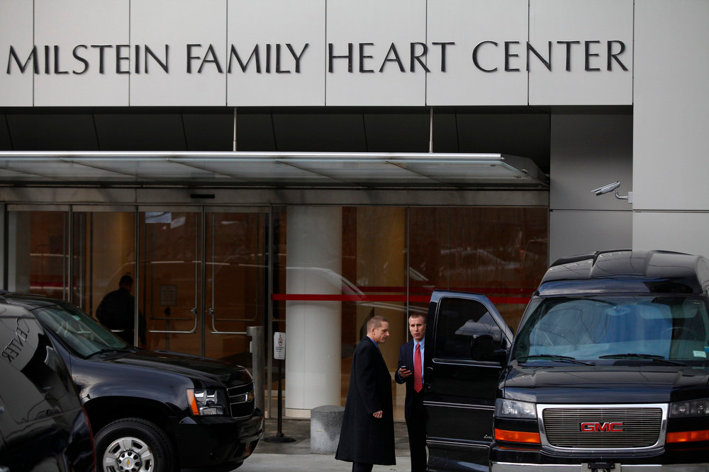 . Members of the Secret Service stand outside the Vivian And Seymour Milstein Family Health Center at the NewYork-Presbyterian Hospital where U.S. Secretary of State Hillary Clinton remains hospitalized in New York, January 1, 2013.  Clinton suffered a blood clot in a vein between her brain and skull behind her right ear but is expected to make a full recovery, her doctors said on Monday in a statement released by the State Department. REUTERS/Joshua Lott