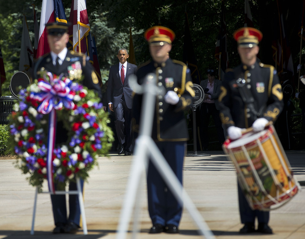 . President Barack Obama arrives to participate in the wreath laying ceremony at the Tomb of the Unknowns, Monday, May 25, 2015, at Arlington National Cemetery in Arlington, Va., on Memorial Day (AP Photo/Pablo Martinez Monsivais)