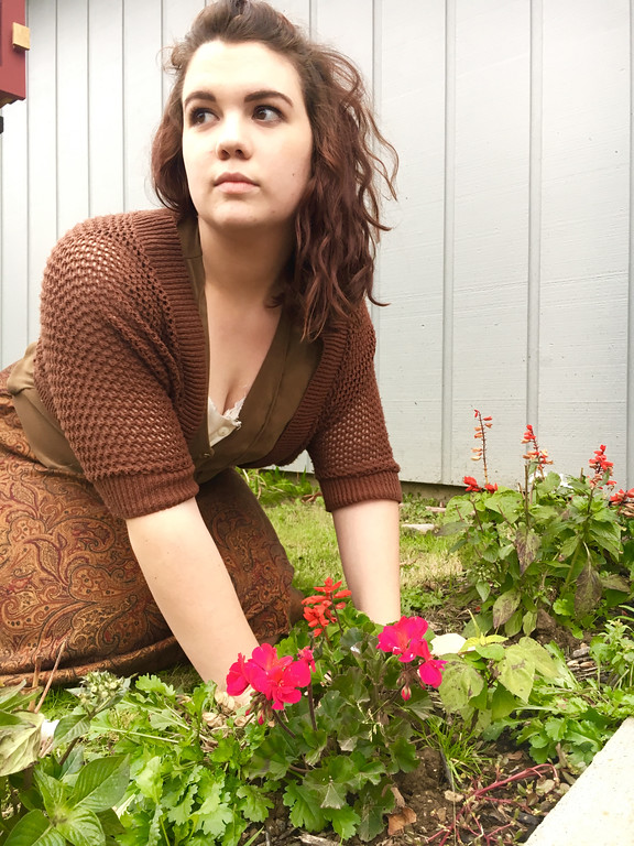 ". Kira (Julia Reid) tends a garden used for supplies to dye thread in ""Gathering Blue,\"" which is on stage at Geauga Lyric Theater at 7:30 p.m. Nov. 10 and 11. For more information, visit www.geaugatheater.org. (Submitted)"