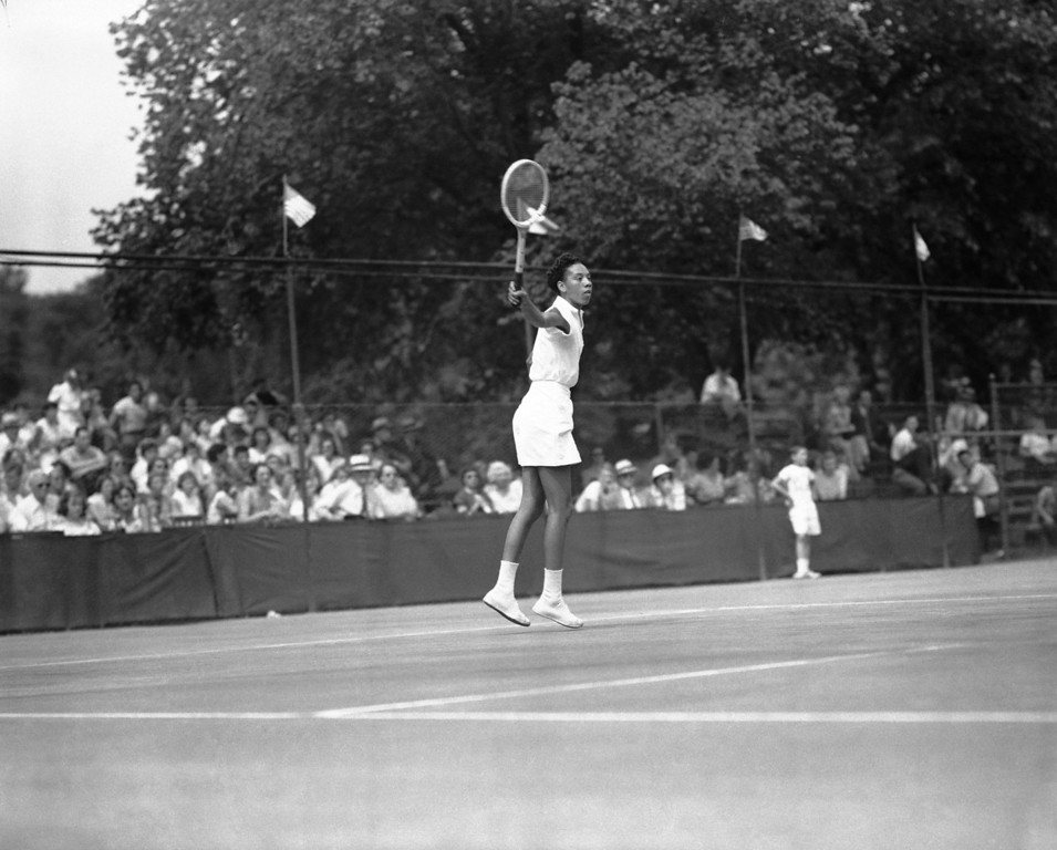 . Althea Gibson, player from Florida A&M College, is shown in action at the U.S. Lawn Tennis Association Clay Courts championships in River Forest, Illinois, July 18, 1950. (AP Photo)