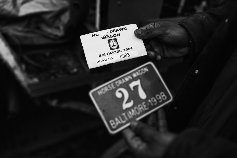 Baltimore -- Launch looks through the wagon and finds the wagon's license plate and credentials on FEb. 23, 2019. Photo by Eric Lee