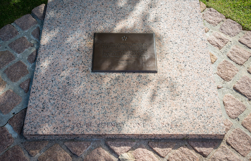 """A time capsule to be opened on June 6, 2044:  """"In memory of GENERAL DWIGHT D. EISENHOWER and the forces under his command this sealed capsule containing news reports of the JUNE 6, 1944 NORMANDY LANDINGS is placed here by the newsmen who were there...June 6, 1969"""""""