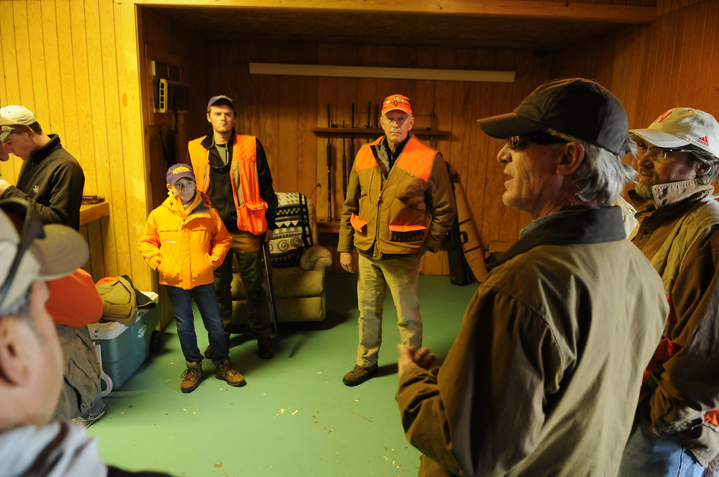 . A group of family and friends gather just after sunrise to discuss safety and strategy before heading out for an annual opening day pheasant hunt, Saturday, November 9, 2013 orchestrated by Holyoke farm owner Rupert O\'Neal, second from right. The crew of 10 hunters bagged 29 birds on the day. Scott Willoughby, The Denver Post