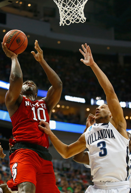 . Lennard Freeman #10 of the North Carolina State Wolfpack puts up a shot in front of Josh Hart #3 of the Villanova Wildcats in the second half during the third round of the 2015 NCAA Men\'s Basketball Tournament at Consol Energy Center on March 21, 2015 in Pittsburgh, Pennsylvania.  (Photo by Jared Wickerham/Getty Images)