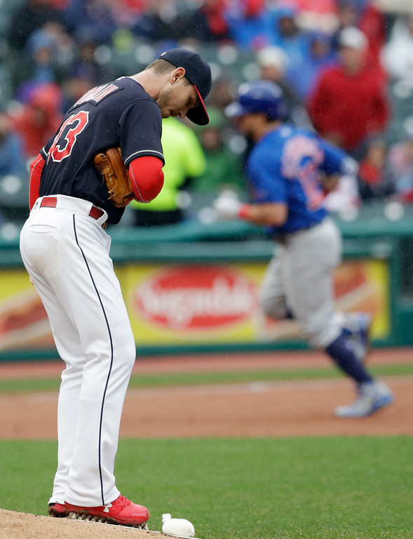 . Cleveland Indians starting pitcher Josh Tomlin, left, waits for Chicago Cubs\' Kyle Schwarber to run the bases on a solo home run during the second inning of a baseball game Tuesday, April 24, 2018, in Cleveland. (AP Photo/Tony Dejak)