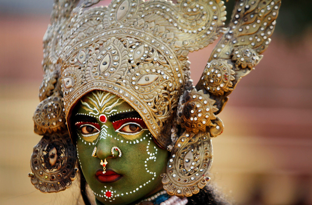 . A women dressed as Hindu Goddess Kali participates in a procession on the eve of Shivratri festival, in Jammu, India, Wednesday, Feb. 26, 2014. (AP Photo/Channi Anand)