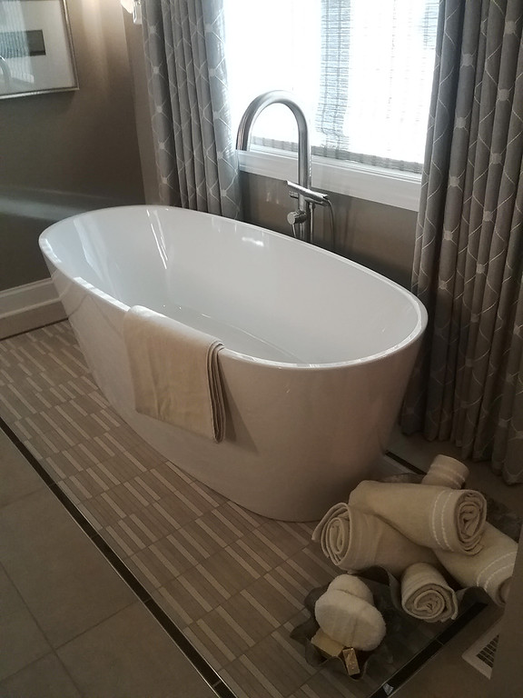 . Specially designed tile in the master bath provides a significant setting for the slipper tub. Gregory Mononen of Gregory Todd Interiors designed the master suite.(Jean Bonchak)