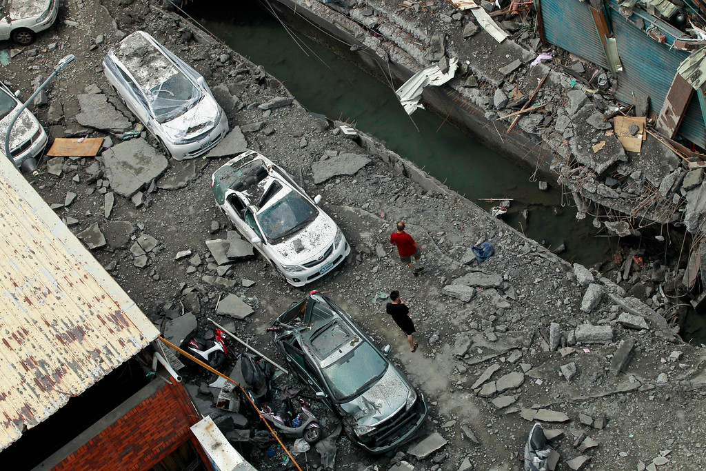 . A rooftop view shows a destroyed street from an massive gas explosion in Kaohsiung, Taiwan, Friday, Aug. 1, 2014. Scores of people were killed and more than 200 others injured when several underground gas explosions ripped through Taiwan\'s second-largest city overnight, hurling concrete through the air and blasting long trenches in the streets, authorities said Friday. (AP Photo/Wally Santana)