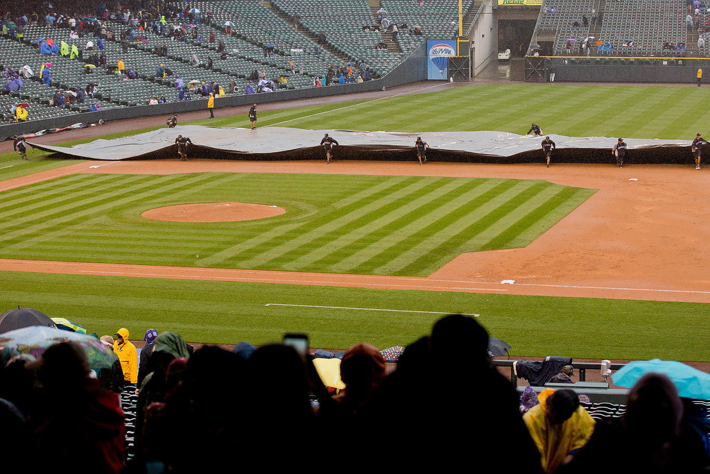 . The grounds crew covers the infield with the tarp as rain falls and halts play during the top of the sixth inning of a game between the Los Angeles Dodgers and Colorado Rockies at Coors Field on June 8, 2014 in Denver, Colorado. (Photo by Justin Edmonds/Getty Images)