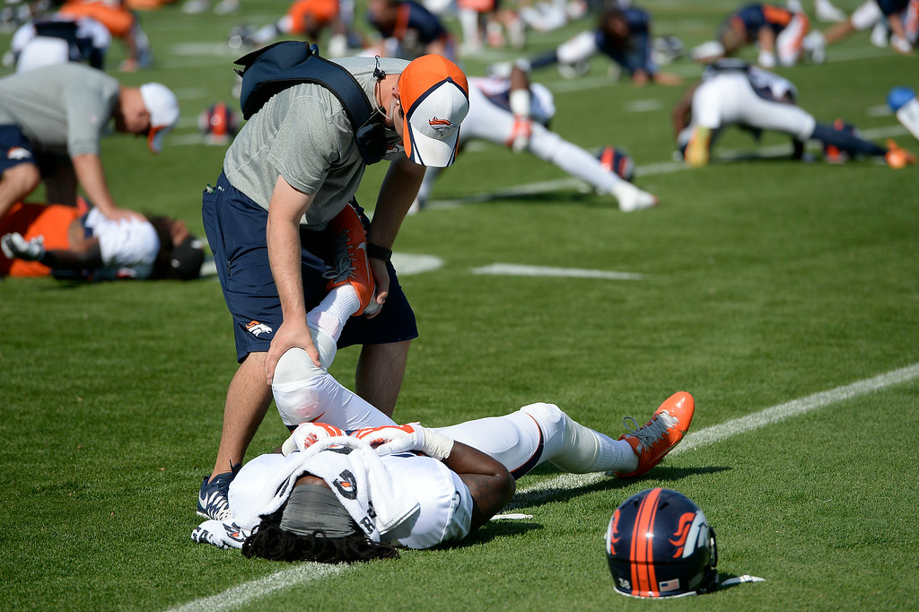 . Denver Broncos strong safety Quinton Carter (38) gets stretch on day five of the Denver Broncos 2014 training camp July 28, 2014 at Sports Authority Field at Mile High. (Photo by John Leyba/The Denver Post)