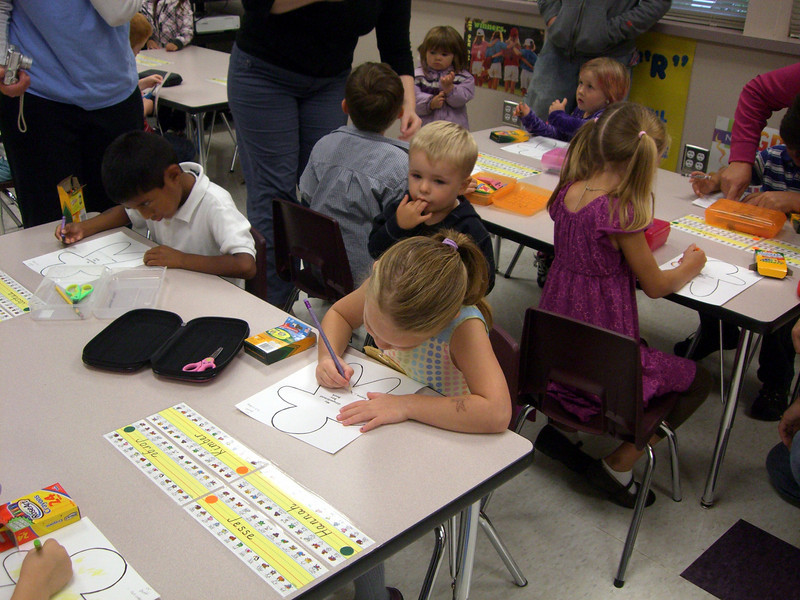 9.10.2009 - First day of kindergarten. At her assigned seat.