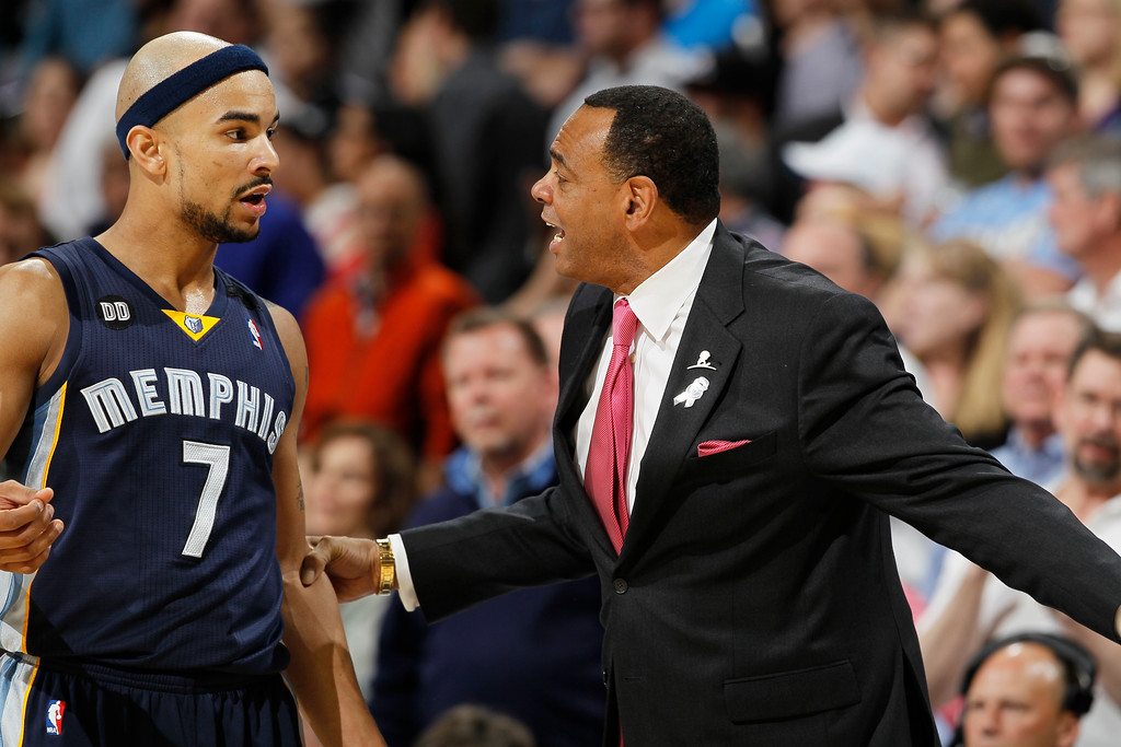 . Memphis Grizzlies head coach Lionel Hollins, right, grabs hold of guard Jerryd Bayless during a time out late in the fourth quarter of the Denver Nuggets\' 87-80 victory over the Grizzlies in an NBA basketball game in Denver on Friday, March 15, 2013. (AP Photo/David Zalubowski)