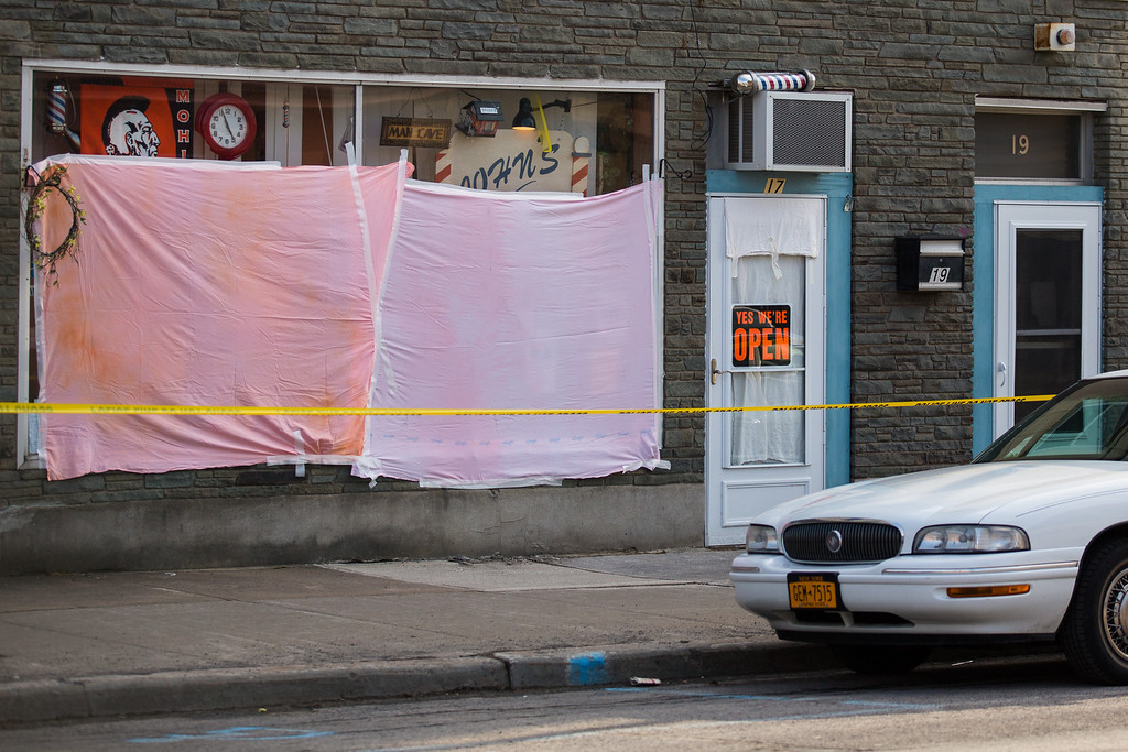 . The windows of John\'s Barber Shop are obscured after a gunman opened fire inside on March 13, 2013 in Mohawk, New York. (Photo by Brett Carlsen/Getty Images)