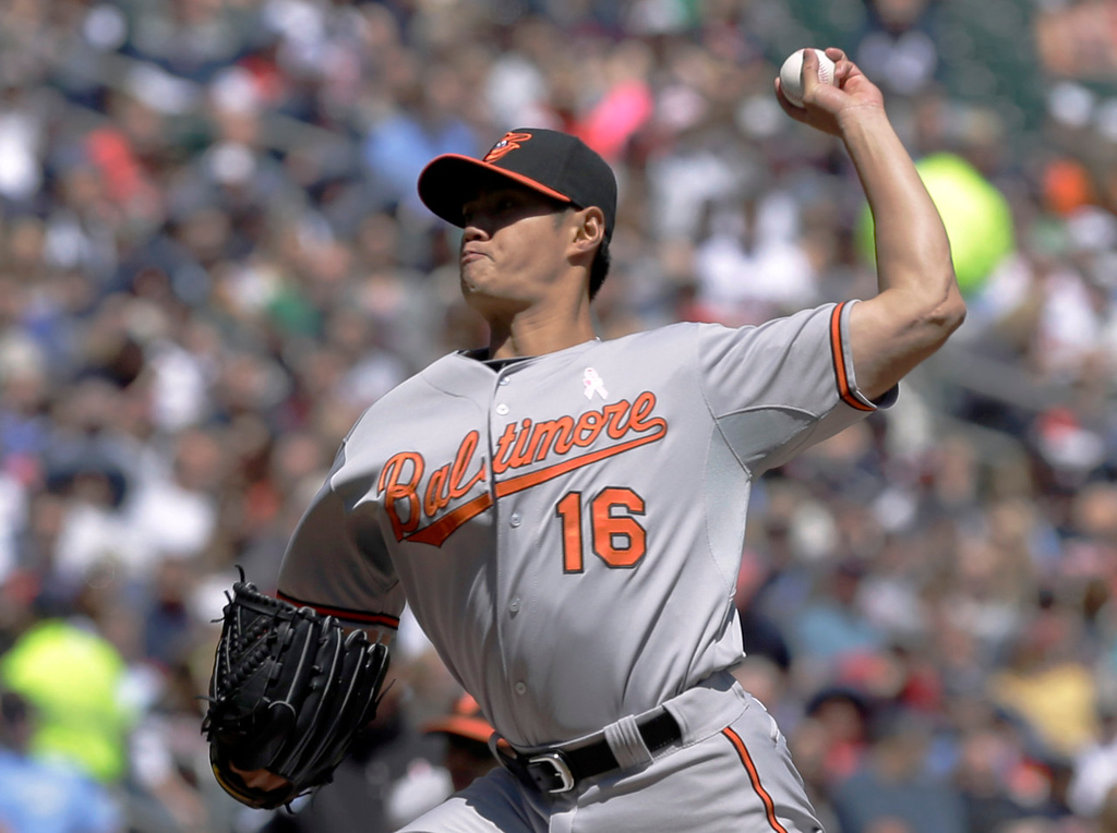 . Orioles starting pitcher Wei-Yin Chen of Taiwan throws against theTwins in the first inning. (AP Photo/Jim Mone)