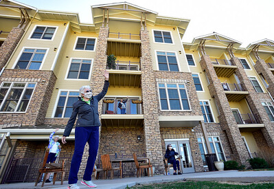 Photos: Broomfield Assisted Living Residents Work Out From Balconies Due to Coronavirus