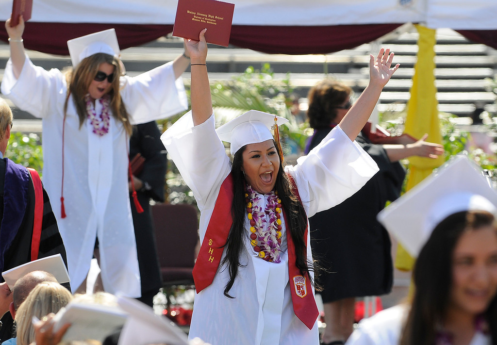 . Kayla Serrano celebrates after getting her diploma. The Commencement Exercises for the Bishop Alemany High School Class of 2013 was held at College of the Canyons in Santa Clarita, CA 6/1/2013(John McCoy/LA Daily News)