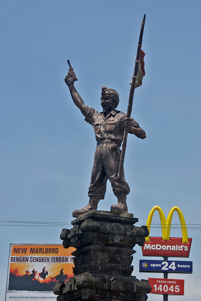 Monument with McDonald's sign in the background in Bali, Indonesia