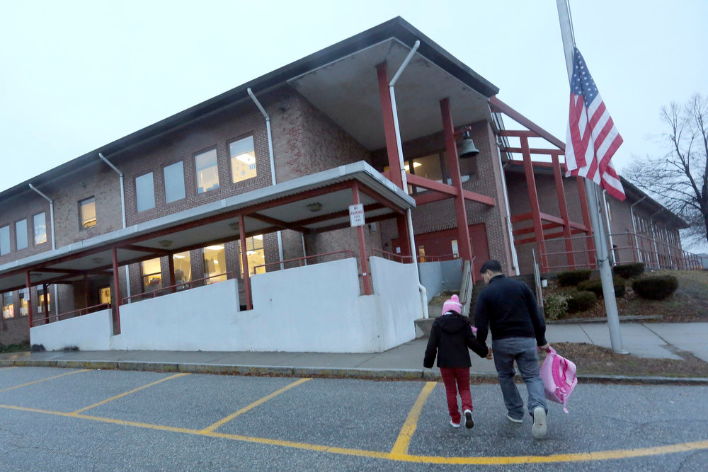 . Manuel Moreno, right, walks his daughter Jady, 6, to the Morris Street elementary school, Monday,Dec. 17, 2012 in Danbury, Conn. Teachers and parents across the country were wrestling with how best to quell children\'s fears about returning to school for the first time since the killings at Sandy Hook Elementary School in Newtown, Conn. (AP Photo/Mary Altaffer)