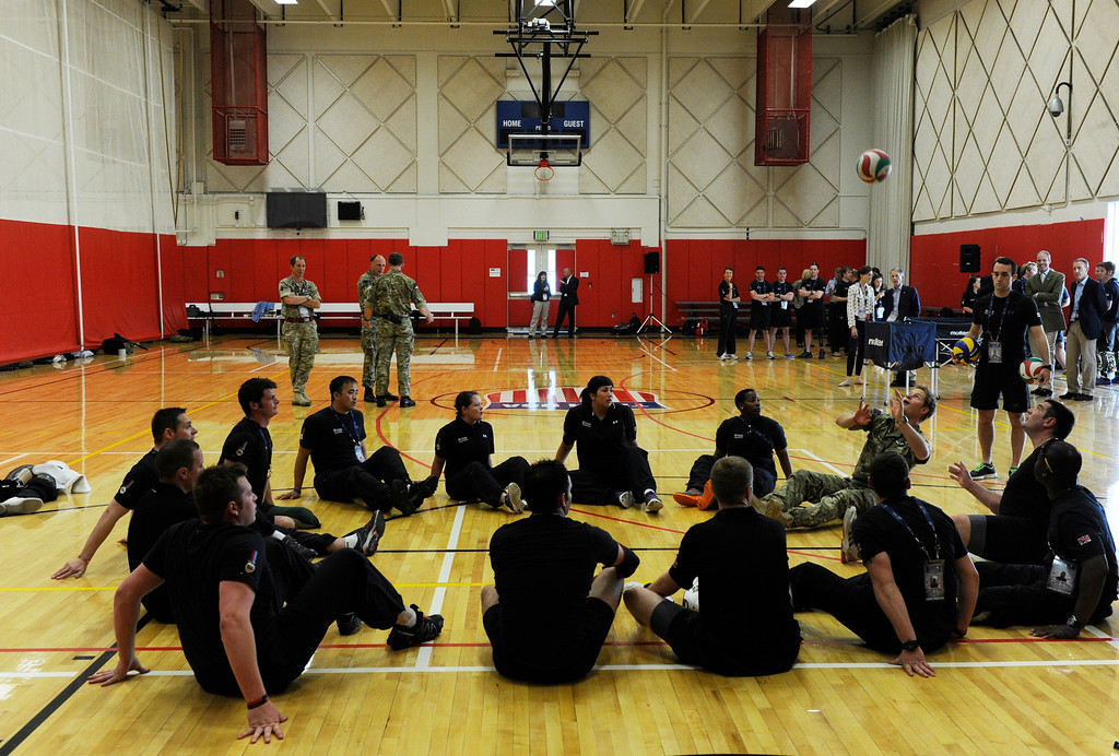 . COLORADO SPRINGS, CO - MAY 11: Britain\'s Prince Harry, upper right, plays a round of sitting volleyball with British Armed Forces volleyball team members at the United States Olympic Training Center before the opening ceremonies at the 2013 Warrior Games Saturday morning, May 11th, 2013.(Photo By Andy Cross/The Denver Post)