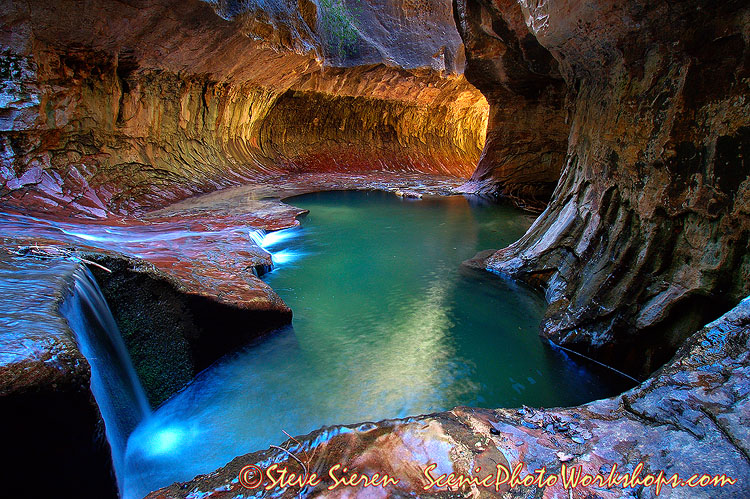 Mysterious Waters  Falling water echoes in the nature carved tunnel where desert salamanders slither, frogs watch in camelflauge as the emerald pools shimmer and tempt cold hikers to go for a swim to releave themselves of the dry desert heat they went throught to make here.