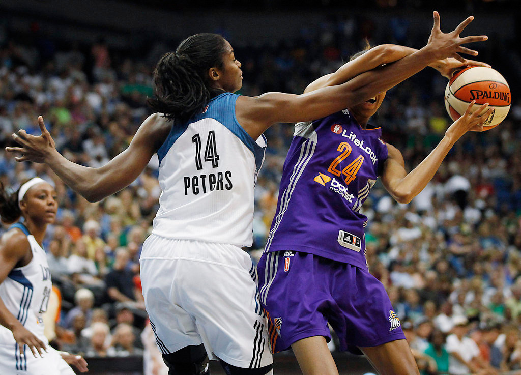 . Minnesota Lynx\'S Devereaux Peters (14) tries to block a pass of Phoenix Mercury guard DeWanna Bonner (24) in the second half of a WNBA basketball game, Sunday, July 7, 2013.(AP Photo/Stacy Bengs)