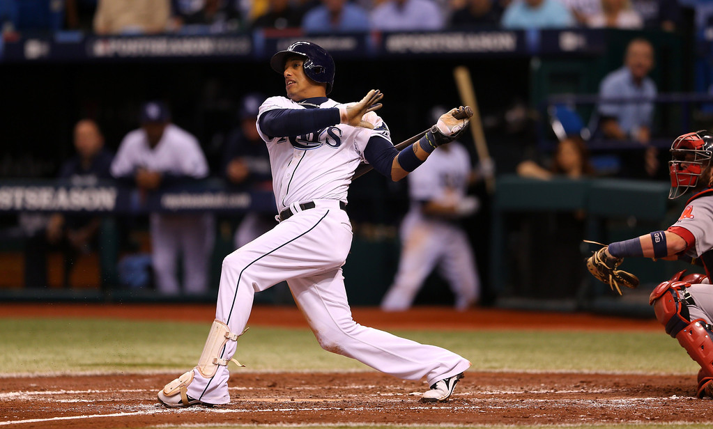 . Yunel Escobar #11 of the Tampa Bay Rays grounds out in the third inning against the Boston Red Sox during Game Three of the American League Division Series at Tropicana Field on October 7, 2013 in St Petersburg, Florida.  (Photo by Mike Ehrmann/Getty Images)