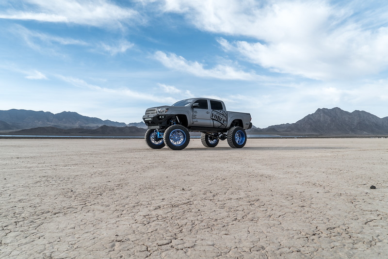 @T_harper96 @Vengeance_tacoma 2005-15 Toyota Tacoma featuring our New 2019 Concave 24x14 Lollipop Blue #GENESIS wrapped in 40x1550x24 @NittoTire-88.jpg
