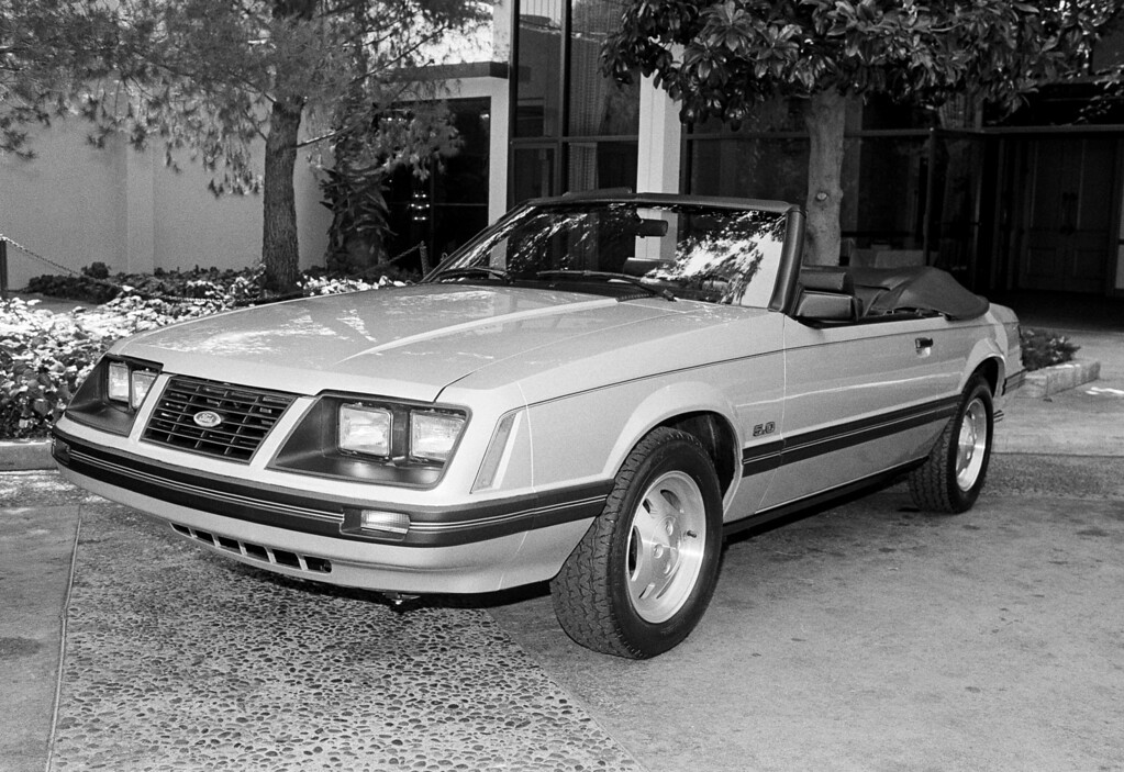 . Seen here is the new 1983 Ford Mustang convertible at a press conference in Los Angeles, Aug. 30, 1982. The 5-litre engine automobile has an estimated base sticker price of $11,000, according to Ford officials, and will cost up to $15,000 with options, maybe more. (AP Photo/ Doug Pizac)