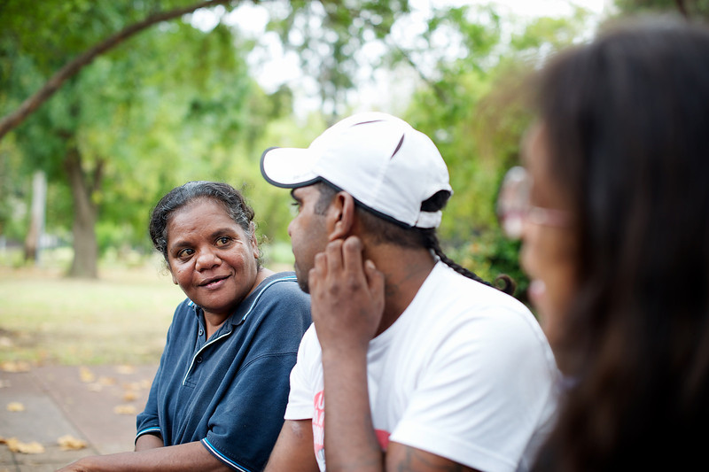 Three Indigenous Australian Adults, outdoors, selective focus