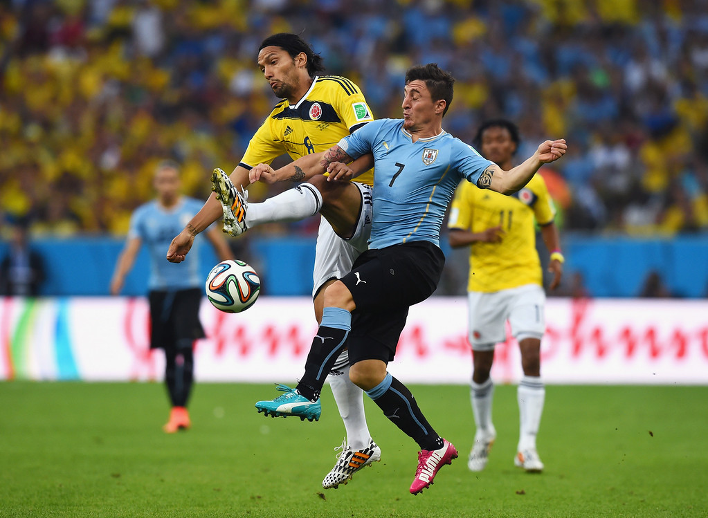 . RIO DE JANEIRO, BRAZIL - JUNE 28: Abel Aguilar of Colombia and Cristian Rodriguez of Uruguay compete for the ball during the 2014 FIFA World Cup Brazil round of 16 match between Colombia and Uruguay at Maracana on June 28, 2014 in Rio de Janeiro, Brazil.  (Photo by Matthias Hangst/Getty Images)
