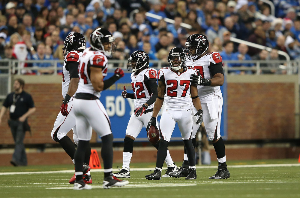 Description of . Robert McClain #27 of the Atlanta Falcons celebrates after recovering the fumble by Calvin Johnson #81 of the Detroit Lions during the second quarter of the game at Ford Field on December 22, 2012 in Detroit, Michigan.  (Photo by Leon Halip/Getty Images)