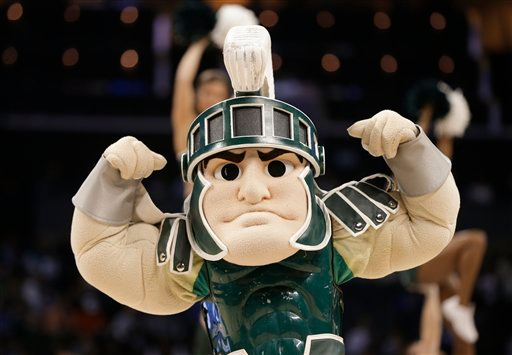 . The Michigan State mascot performs during the first half of an NCAA tournament college basketball game against Virginia in Charlotte, N.C., Sunday, March 22, 2015. (AP Photo/Nell Redmond)