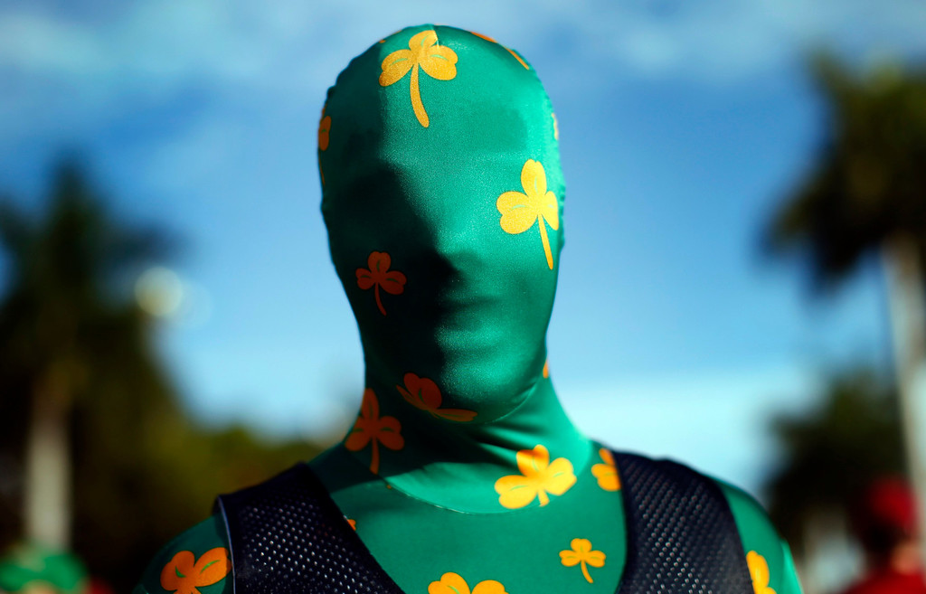 . Adam Soisson, a freshman at Notre Dame University, stands dressed in a costume outside Sun Life stadium before the BCS National Championship college football game between the Alabama Crimson Tide and the Notre Dame Fighting Irish in Miami, Florida January 7, 2013.  REUTERS/Mike Segar