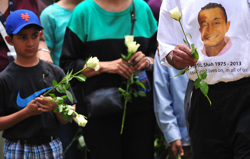 . Relatives of Mitul Sha who was killed during the Westgate Mall attack, carry flowers  during a ceremony marking the first anniversary of the attack, outside the Westgate mall in Nairobi on September 21, 2014. At least 67 people were killed and scores wounded when a small group of Al-Qaeda affiliated fighters stormed the Westgate mall on September 21 2013. CARL DE SOUZA/AFP/Getty Images