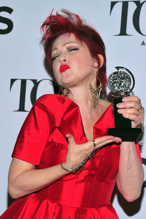 ". Cyndi Lauper poses with her award for best musical score for ""Kinky Boots\"" in the press room at the 67th Annual Tony Awards, on Sunday, June 9, 2013 in New York.  (Photo by Charles Sykes/Invision/AP)"