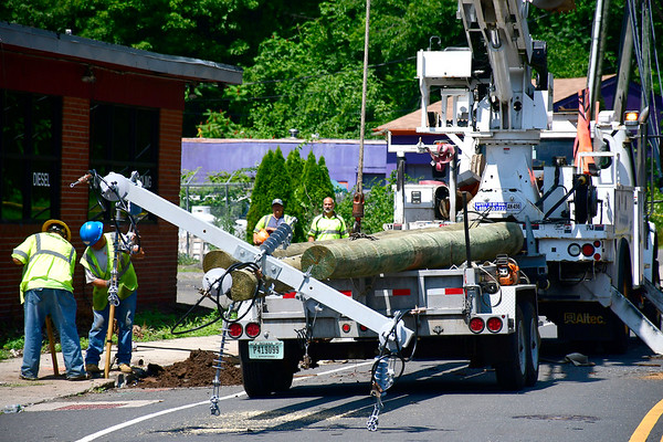 7/18/2019 Mike Orazzi | Staff Crews work to re-open Brook Street between Stafford Av and Manross Rd due to downed power lines on Friday morning. It is estimated to reopen by 5:00 pm.