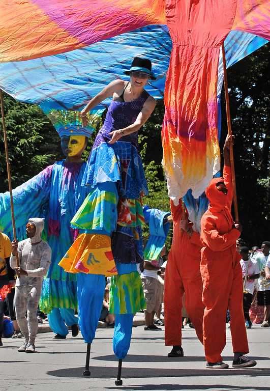 . Jeff Forman/JForman@News-Herald.com Robin Van Lear, creator and director of Parade the Circle, marches and dances on stlits along with the giant puppets and creations she\'s designed and inspired for the event during the 25th parade June 14 in University Circle.
