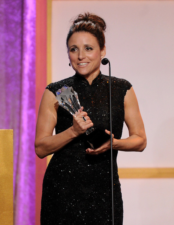 """. Julia Louis-Dreyfus accepts award for best actress in a comedy series for \""""Veep\"""" at the Critics\' Choice Television Awards in the Beverly Hilton Hotel on Monday, June 10, 2013, in Beverly Hills, Calif. (Photo by Frank Micelotta/Invision/AP)"""