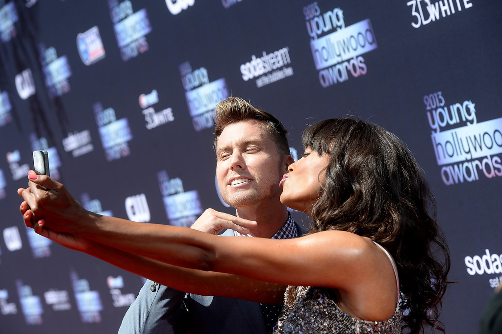 . Recording Artist Lance Bass (L) and actress Aisha Tyler attend CW Network\'s 2013 Young Hollywood Awards presented by Crest 3D White and SodaStream held at The Broad Stage on August 1, 2013 in Santa Monica, California.  (Photo by Michael Buckner/Getty Images for PMC)