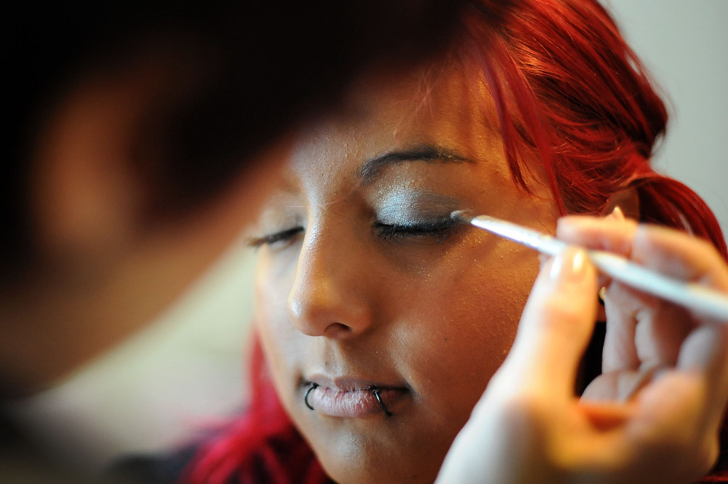 . Rosa Castillo gets her makeup done during Operation School Bell\'s annual Prom Day event at the Assistance League of Los Angeles Thursday March 7, 2013.  Fifty-five homeless or needy LAUSD high school girls were able to select a dress, shoes and accessories during the event.(Andy Holzman/Los Angeles Daily News)