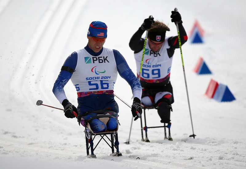. (L-R) Andrew Soule of USA and Vladimir Gajdiciar of Slovakia compete in the Men\'s 7.5KM Sitting Biathlon event during day one of Sochi 2014 Paralympic Winter Games at Laura Cross-country Ski & Biathlon Center on March 8, 2014 in Sochi, Russia.  (Photo by Ronald Martinez/Getty Images)