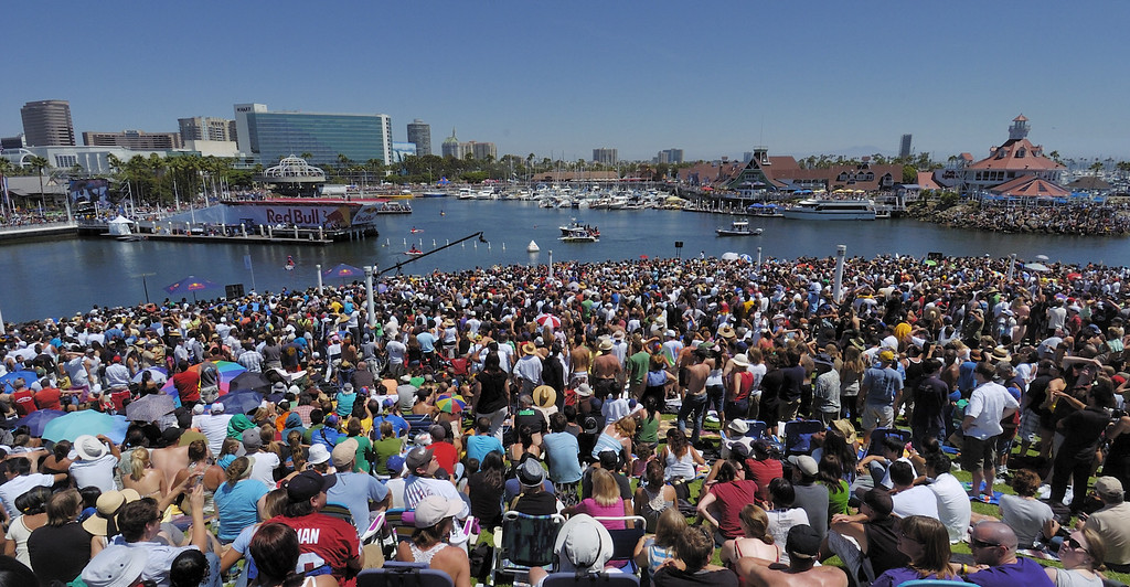 """. LONG BEACH, CALIF. USA -- Thousands of people line Rainbow Harbor during Flugtag in Long Beach, Calif. on August 21, 2010. Thirty five teams competed in the Red Bull event where teams build homemade, human-powered flying machines and pilot them off a 30-foot high deck in hopes of achieving flight.  Flugtag means \""""flying day\"""" in German. They are on distance, creativity and showmanship..Photo by Jeff Gritchen / Long Beach Press-Telegram.."""