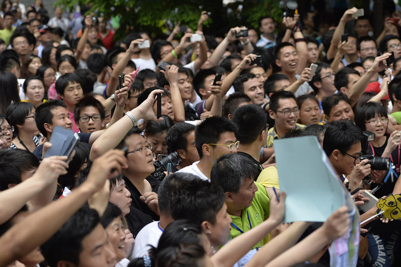 . Fans cheer as David Beckham arrives at Tongji University on June 20, 2013 in Shanghai, China.  (Photo by ChinaFotoPress/Getty Images)