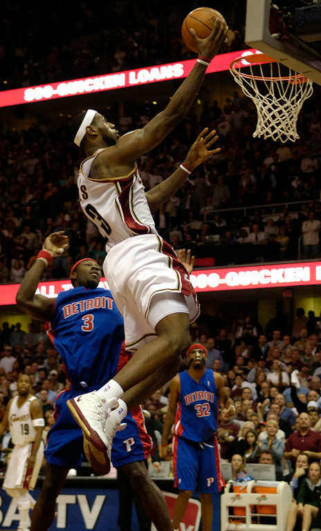 . Ken Blaze/KBlaze@News-Herald.com LeBron James puts in two past Detroit\'s Ben Wallace Saturday at the Q.